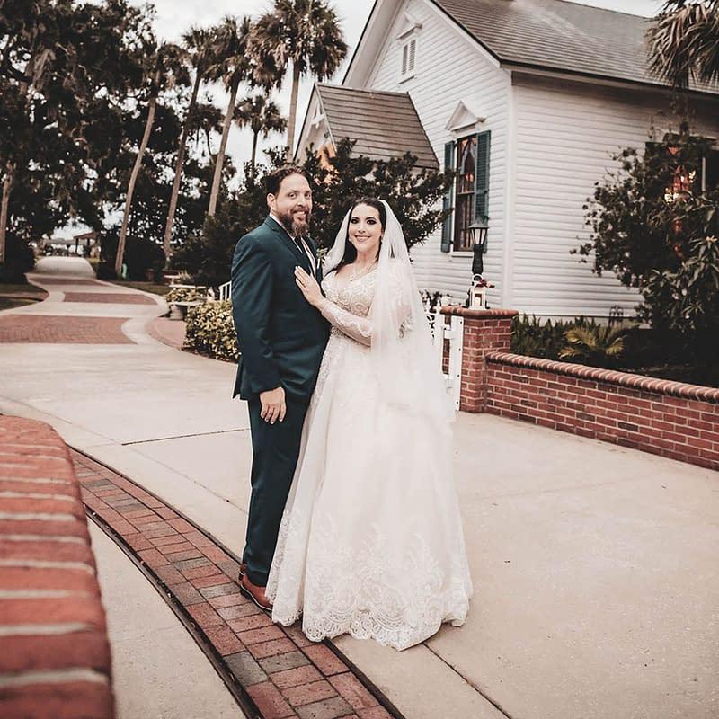bride in wedding dress and groom in tuxedo