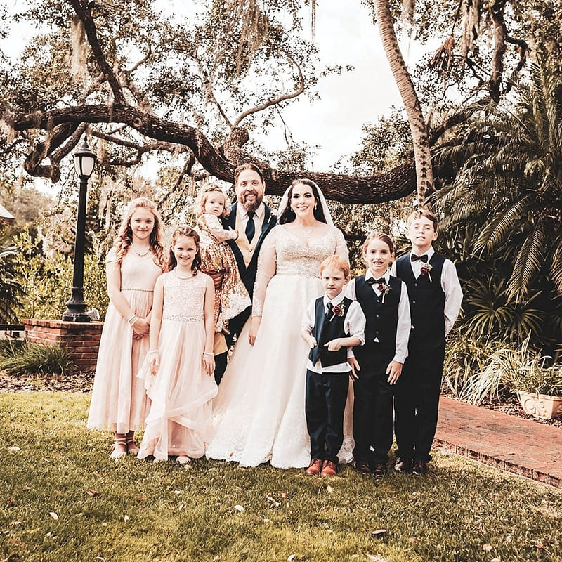 wedding dress and tuxedo with flower girls and ring bearer
