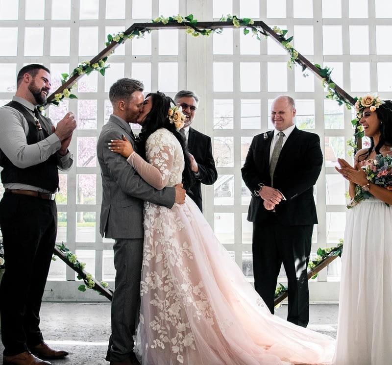 couple getting married in tuxedo, wedding dress