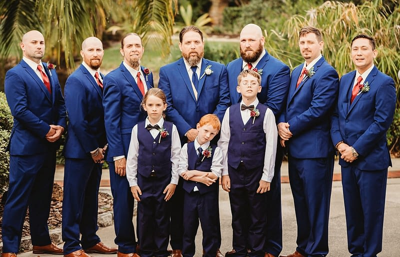 groom and groomsmen in tuxedos with ring bearer